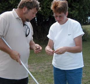 Gina Badgett and a volunteer